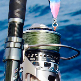 close-up view of ocean fishing rod with ocean in background